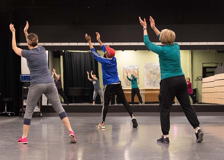 Group of adults performing choreography in dance class